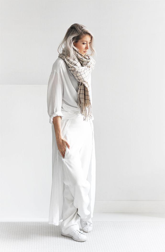 @joycecroonen breaks out her crisp winter whites, pairing a simple shirt-dress…