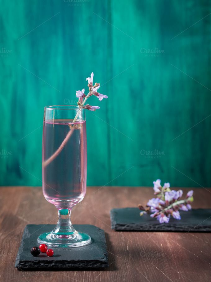 Violet drink on green background by Life Morning Photography on @creativemarket
