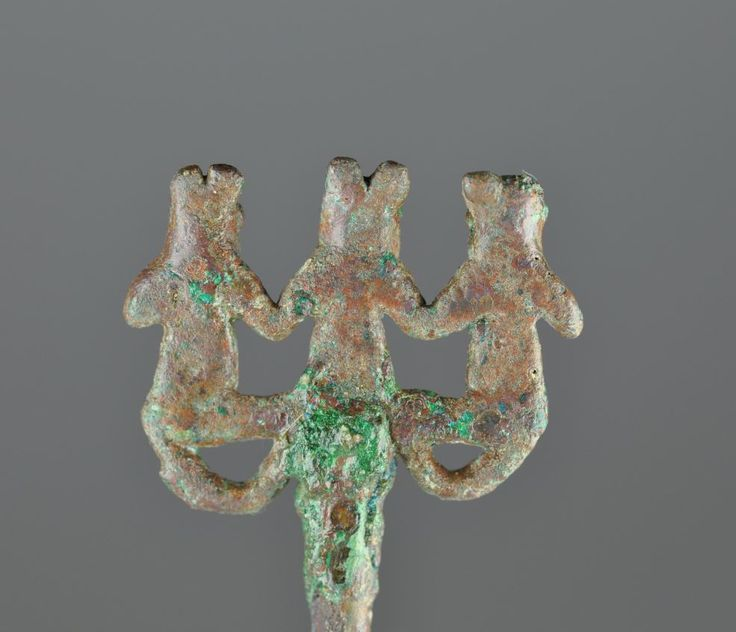 Amlash bronze pin with three animal headed figures holding hands, 1st millenium B.C. 10 cm high pin, 2 cm high three figures, unpublished. Private collection