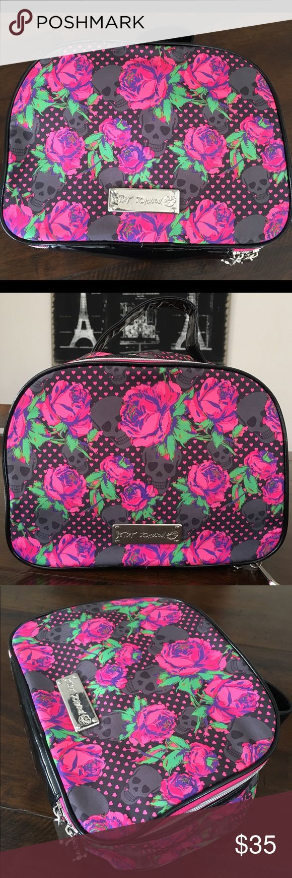 """Betsey Johnson Skulls & Roses Travel Make-Up Bag Grey skulls, pink hearts/roses detail this flirty, Betsey Johnson, zip around closure, single patent leather top handle, measuring 8"""". Patent leather bottom. Lay flat to open and toss in those must have items when traveling and on the go, or as a make-up storage bag. In perfect condition! Zipper functions properly. No rips/stains, inside/out. Bag dimensions:10""""W, 8""""H, 6""""D, 26"""" zip around. When open, bag is capable of expanding 15""""W/14""""H. Carry…"""