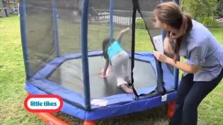 toddler jumping on enclosed trampoline - YouTube