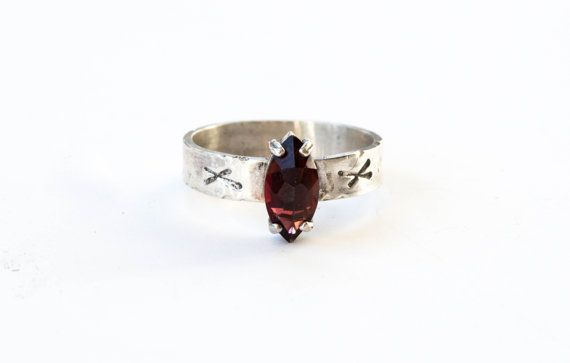 A beautiful 8x4 faceted garnet is set upside down in a flat sterling silver prong. The band is 4x1mm sterling silver, not too thick but still extremely sturdy and durable. On each side of the stone I place a nauthiz rune.  This ring is polished but I leave a little oxidation to make it look rustic. You can request full oxidation, but its not permanent.  Please select your correct size from the drop down menu.  Feel free to contact me with any questions