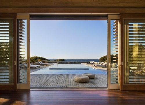 The view from inside the pool house to the pool and the Atlantic Ocean beyond is sublime.