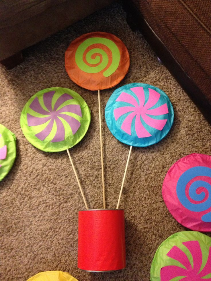 In the making of my candyland centerpieces. Paper plates wrapped with tissue paper and card stalk color paper for swirls.