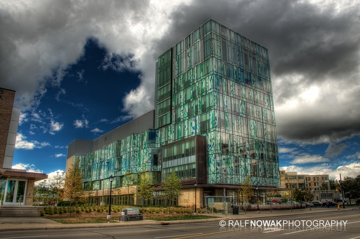 School of Pharmacy, University of Waterloo. Distinctive for its colourful curtain wall featuring images of medicinal plants, the School of Pharmacy building optimizes natural light and uses organic materials such as wood and stone. Waterloo, Ontario, Canada | by Ralf Nowak, via 500px