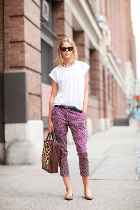 Frida Gustavsson is casual but collected in cropped pants and a white tee.