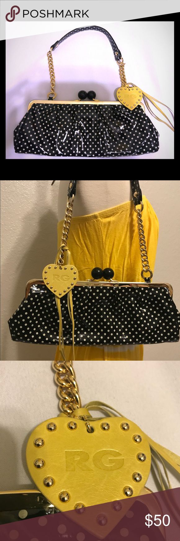 Roberta Gandolfi kiss-lock polka dot clutch bag Black with white polka dots, yellow heart with designer initials and two yellow leather cords. Hardware is gold tone. This is a great bag for a night of fun with the girls. It's quite the attention grabber. It's young, unique, 100% Italian patented leather. Made in Italy 🇮🇹  The kiss lock is black with an interior zippered pocket to keep keys, ID, cash, credit cards safe. Tiny bit of rusting in the interior, see picture.   14L x 5.25H x 5D…