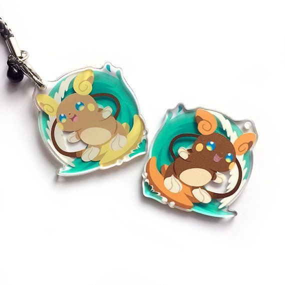 This Alolan Raichu charm features a surfing Raichu on one side and a SHINY raichu on the other! The back is also spot glossed to accent the design :)  This Pokemon charm is approximately 1.75 tall and professionally printed on clear acrylic with spot gloss to accent the art. The ink is waterproof and very scratch resistant. Perfect for hanging off phones, backpacks, game consoles or clothing. All charms are printed and manufactured in the USA.  All charms come with a custom made durable…