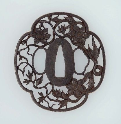 Tsuba with design of clematis.      Japanese, Edo period, Late 18th–early 19th century (?) .