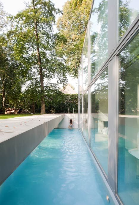 This glass house byBelgian architectsGovaert & Vanhouttehas a 50-metre-long wall at the back and a sunken swimming pool at the front.  [Photography is by Tim Van de Velde.]