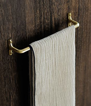 Wow. If I would go gaga over a towel hanger, it would be over this one. I'm picky about that part where they connect with the wall, whatever it's called - I like them to be rectangular like this, not round.    Towel Hanger by Masanori Oji