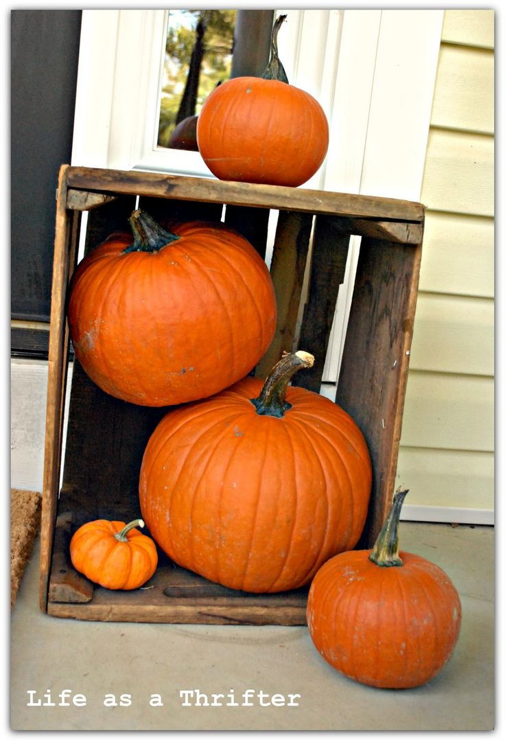 Fall porch decor with pumpkins and a crate!