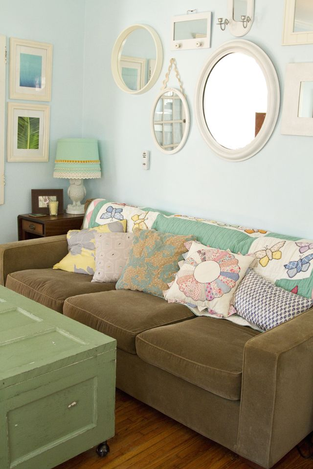 Pretty color combinations. Pale brown, pale green and a pretty mirror wall display