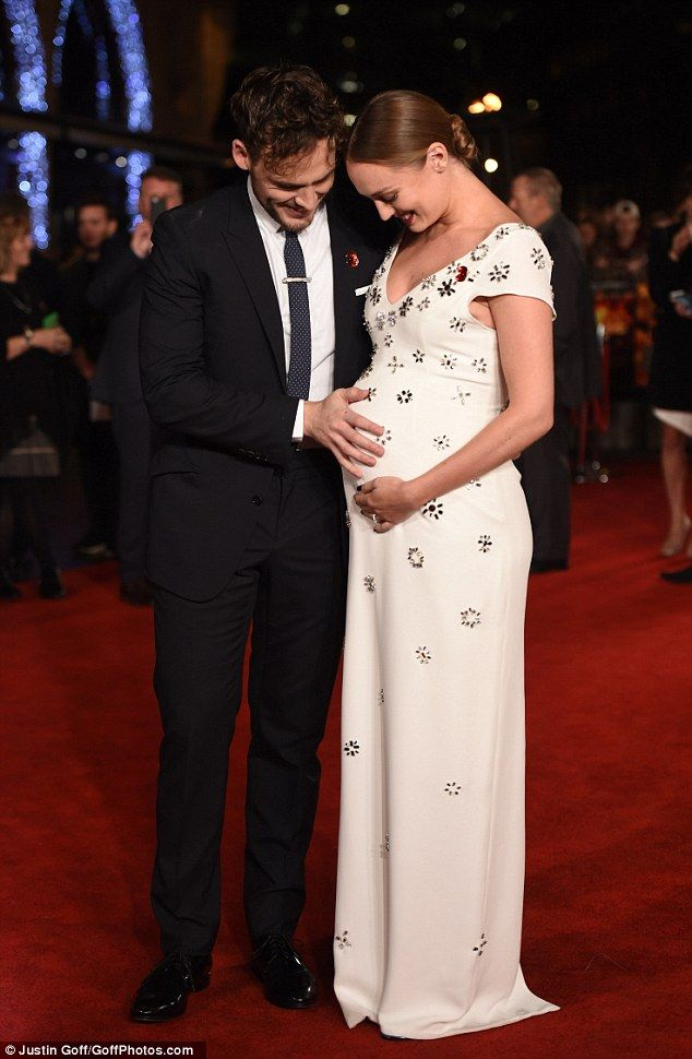 Expecting: Sam Claflin revealed that he and wife Laura Haddock were pregnant on Thursday night as she stepped out to support him at the Hunger Games: Mockingjay - Part 2 premiere