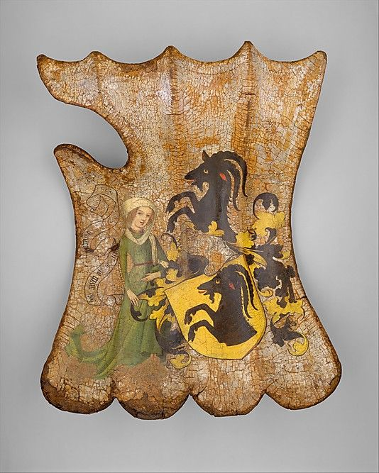 Tournament Shield (Targe) Date: about 1450 Culture: German Medium: Wood, leather, linen, gesso, polychromy, silver Dimensions: H. 22 in. (55.88 cm) W. 16 in. (40.64 cm) Classification: Shields Credit Line: Gift of Mrs. Florence Blumenthal, 1925 Accession Number: 25.26.1