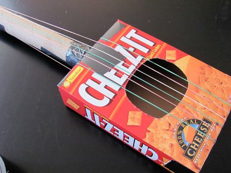 Make a toy guitar out of recycled materials rock 39 n 39 roll for Cool recycled stuff