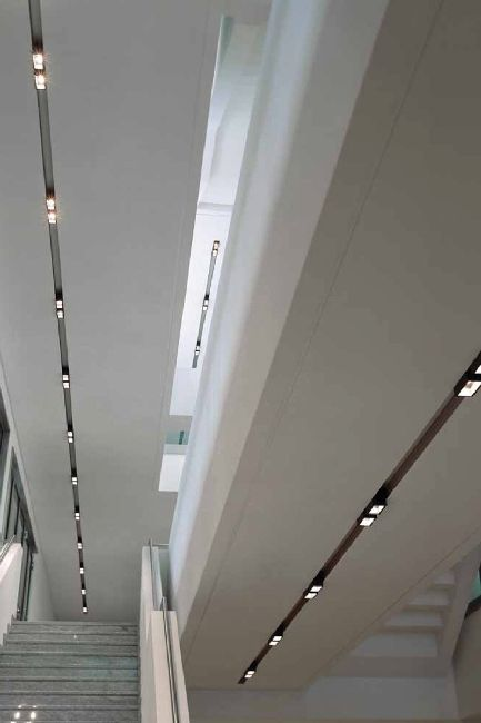 Clean and minimalist white ceiling with integrated lighting _