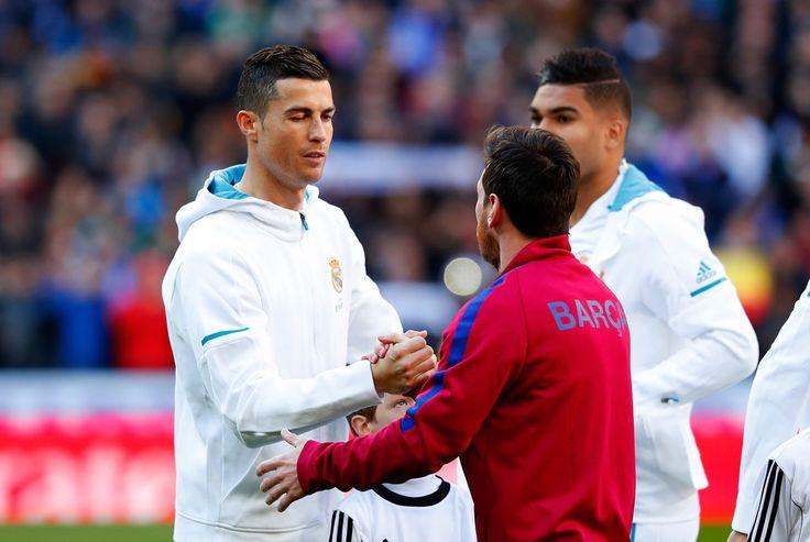 Cristiano Ronaldo Photos - Cristiano Ronaldo of Real Madrid greets Lionel Messi of Barcelona prior to the La Liga match between Real Madrid and Barcelona at Estadio Santiago Bernabeu on December 23, 2017 in Madrid, Spain. - Real Madrid v Barcelona - La Liga