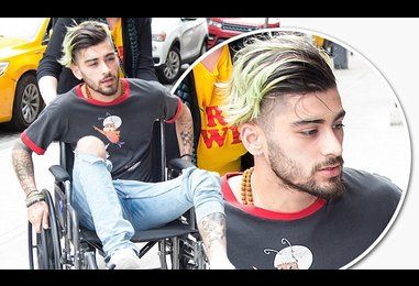 Zayn Malik wheeled into Gigi Hadid's flat after injury