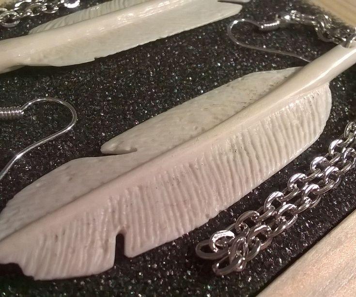 Feather shaped bone earrings