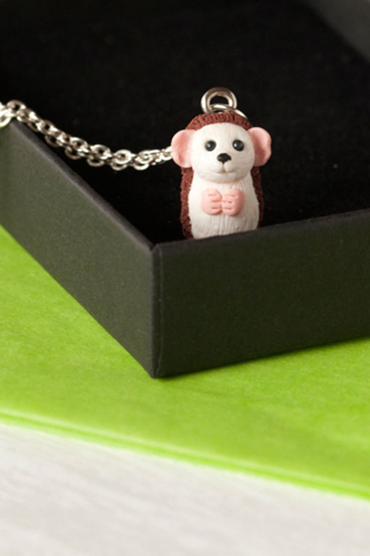 Teeny miniature hedgehog necklace. Happily awaiting adoption.
