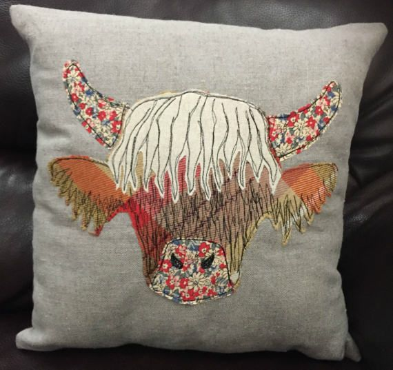 Please note these 2 designs have now sold, Fabrics may vary from the pictures listed. Orders will be made and shipped within 3 working days. This cushion cover is made from one of my original applique and freehand machine embroidered Highland Cow designs. The cover measures approx 16 x 16 and comes complete with a hollow fibre cushion.  Each one of my cushions is totally unique, using different upcycled fabrics.  The Highland Cow design is created using pieces of beautiful fabric, I then…