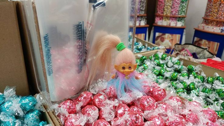 """Peony the traveling troll at the Lindt outlet in Birch Run bathing in truffles ;) She's wearing a """"Rainbow Yeti"""" as a coat:)"""
