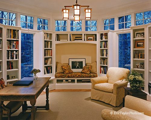 Craftsman style lighting with traditional built-in bookcases, clerestory windows and beautiful floor to ceiling windows. Bethesda home contemporary home office