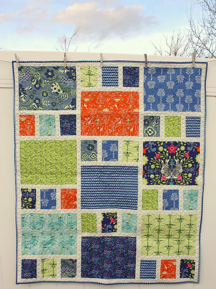 A simple and quick quilt made from 8 fat quarters plus solid sashing, subcut fat quarters into 1 big rectangle and 3 smaller rectangles, from: Diary of a Quilter - a quilt blog: Safari Moon - new Art Gallery Fabrics quilt