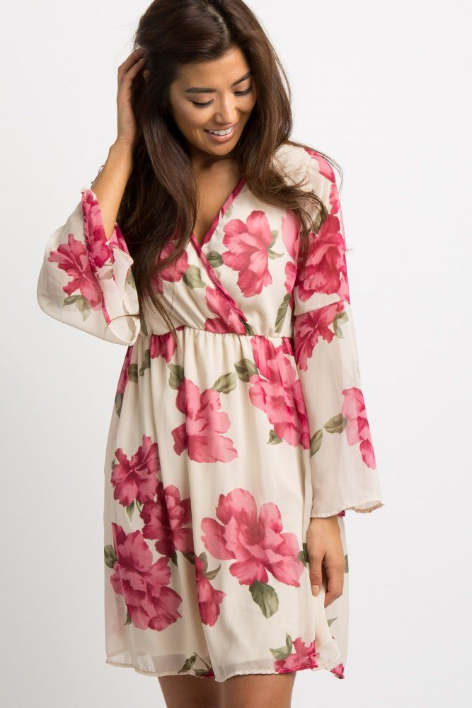 84e4040d4b104 A floral, chiffon dress featuring a wrap v-neckline, semi-sheer long bell  sleeves, and a cinched elastic waistline. Body is double lined to prevent  ...
