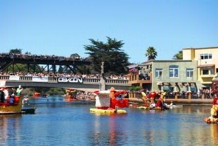 Capitola Begonia Festival floats coming down the Soquel Creek into Capitola