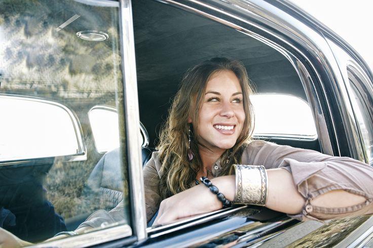Mixed race woman driving vintage car - Mixed race woman driving vintage car