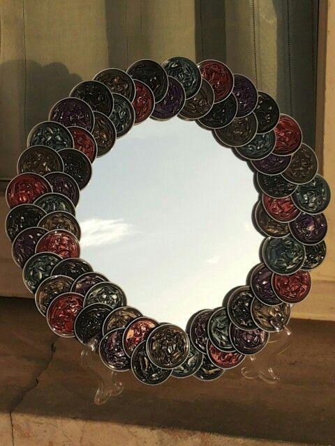 Specchio con cornice fatta da capsule nespresso #Nespresso