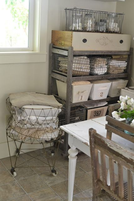 Wire laundry basket & old wood shoe rack for linen storage in Laundry Room. Would also be cute for storing fabrics or craft items in any studio.