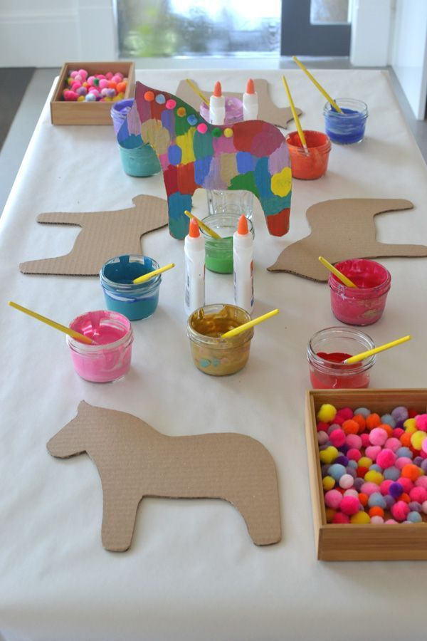 Cut Dala horse shapes cardboard and decorate them as a way to celebrate Cinco De
