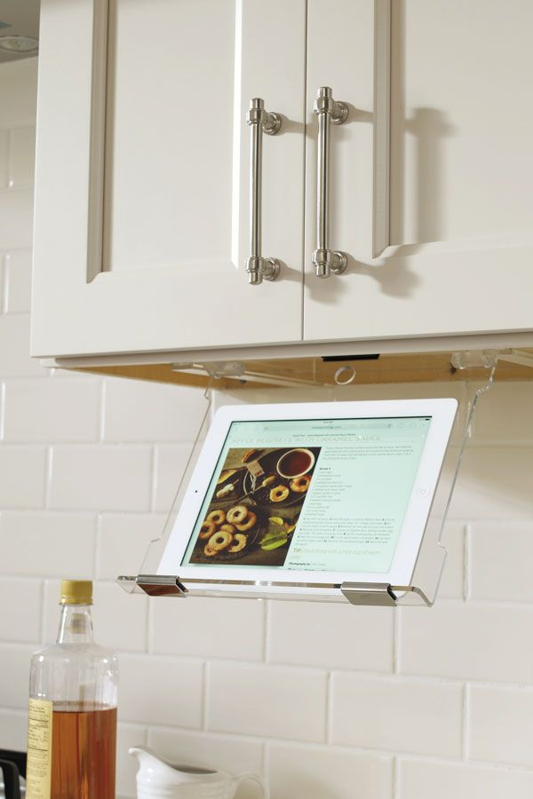 Tucked up under the cabinet bottom, our tablet holder pulls down and keeps the tablet from harms way.