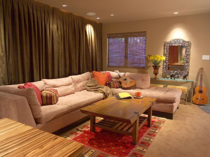 a relaxing sectional sofa sits cozily in this neutral toned asian style living room