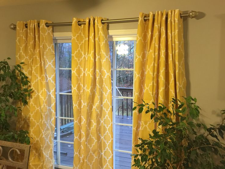 Removed outdated vertical blinds and added trendy pattern curtains.
