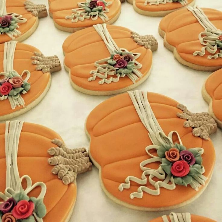 decorated sugar cookies pumpkin with flowers and raffia