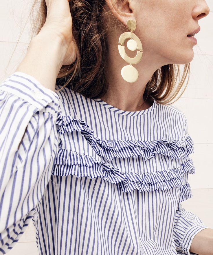 Off the shoulder tops do NOT work for me, but I love how this mimics one with the puffy sleeves and ruffles. I would so wear this striped beauty!