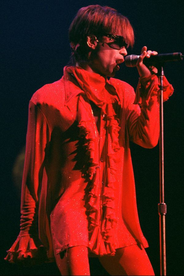 Look closely: The glittery red fabric on Prince's concert garb for The Artist Prince (1998) glimmers in the spotlight.  #refinery29 http://www.refinery29.com/2016/04/108919/prince-fashion-outfits-style#slide-12