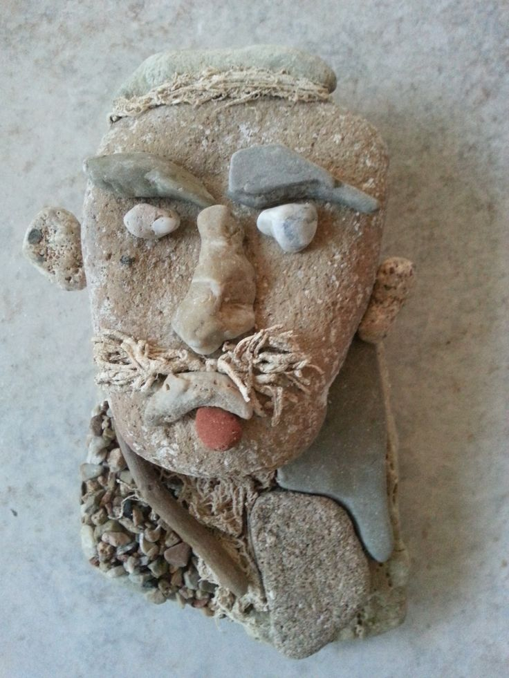 Captain Simis- stone, pebbles,seaweed and driftwood