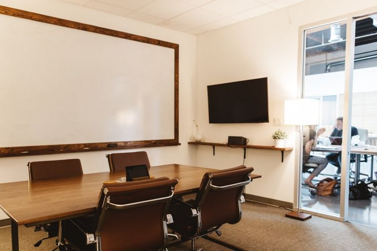 Photo of Fldwrk - Costa Mesa - Costa Mesa, CA, United States. Private meeting room available to rent out by the hour. Includes video conference call, display and large whiteboard.