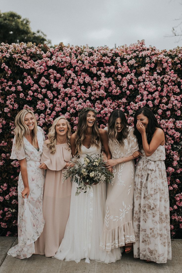 These cute bridesmaids had the perfect boho mismatched dresses. Perfectly matching that pink flower wall too!