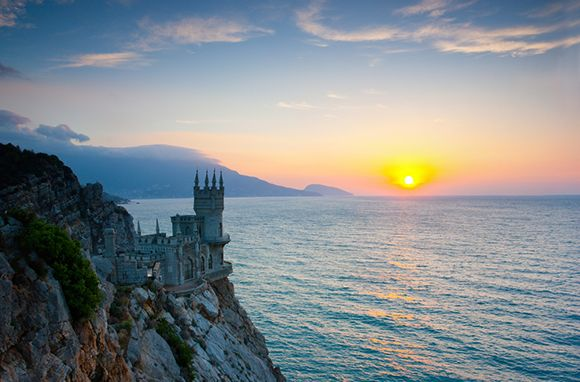 Swallow's Nest, Ukraine  Like something out of Tolkien or George R.R. Martin, it's easy to imagine the neo-gothic Swallow's Nest castle in southern Ukraine belonging to a fantasy world where dragons rule the skies. Even without the dragons, this 100-year-old castle looming over a 130-foot cliff is one of the most popular tourist attractions on the Crimean peninsula.