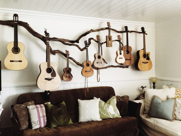 We planted ourselves a little guitar tree and this is our first years harvest! Hoping for larger crop next year, maybe the uke buds will grow into an Olson, Ryan, Santa Cruz , but even a Taylor would be nice! My husband is an amazing artist! I asked for a creative guitar hanger and this is what he came up with.
