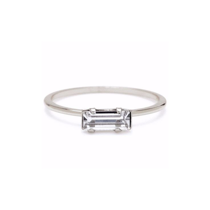 A delicate band featuring a sparkling Swarovski baguette crystal. Perfect for stacking, particularly with the Tiny Marquis ring, and can also be worn as a midi