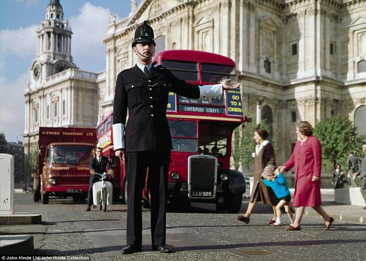 Bobby on the job: A policeman directs traffic near St St Paul's Cathedral in front of an inconic London Routemaster bus in the 1960s