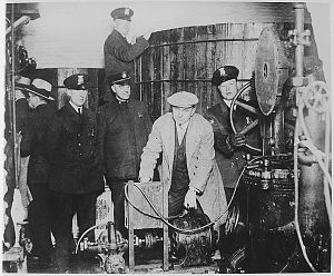 All You Need to Know About Prohibition: Detroit police inspecting equipment found in a clandestine underground brewery during the Prohibition era.