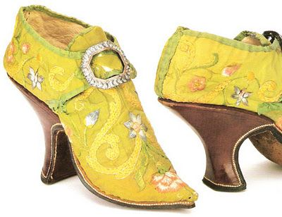 """Note of interest - in the seventeenth century men wore heels. The yellow and red mules were most likely mens' shoes. The yellow mules are from Italy and were made in the 18th century.""  --Sylvia Windhurst"